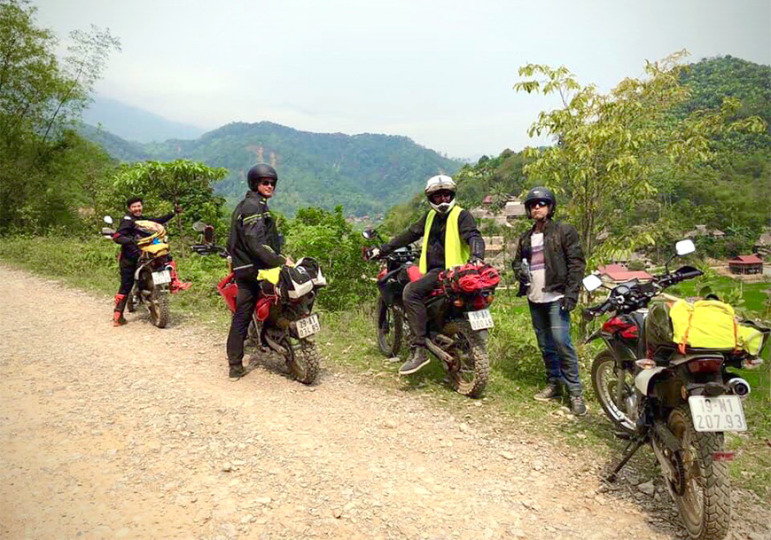 Group of tourists on Motorbike tour - Vietnam Northern Loop